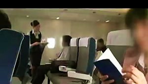 Japanese Stewardess Gives A Passenger A  During The Flight